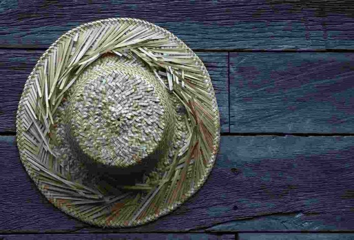 Old Straw hat Wooden Surface